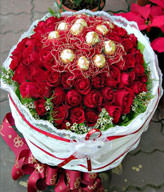 50 red roses and Ferrero Rocher 12