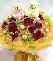 11 Red roses,11 chocolate flowers,A pair of bear